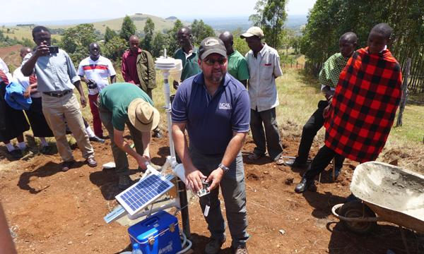 Demonstrating a 3D-printed weather station in Kenya