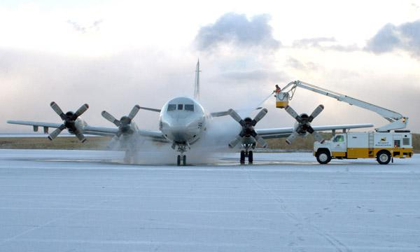 An aircraft is deiced on the runway
