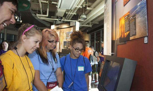 Students look at an NWSC exhibit